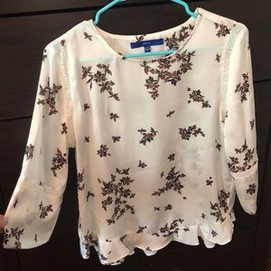 White blouse with flower pattern